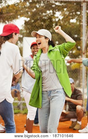 Cheering friends playing baseball