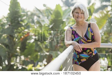 Caucasian woman standing in bathing suit
