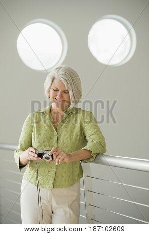 Caucasian woman looking at digital tablet