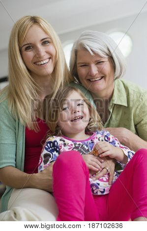 Smiling Caucasian grandmother, mother and daughter