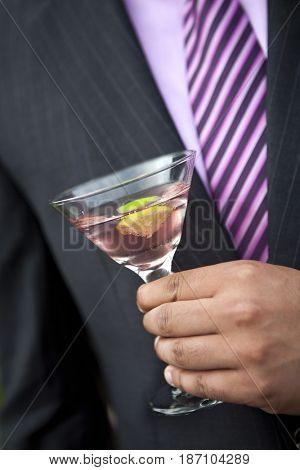 Man holding pink martini