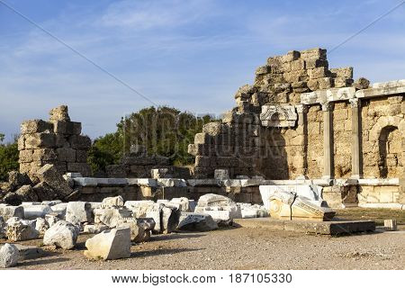 The old ruined walls of the ancient city . Beautiful background with ancient ruins and Sunny summer day