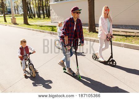 Young family on bicycles at path in park