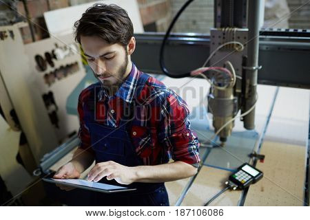 Engineer with touchpad browsing in the net