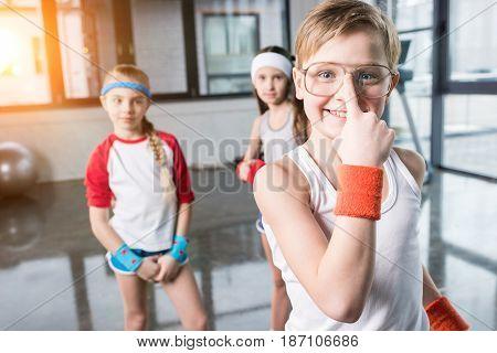 Adorable Kids In Sportswear Fooling Around At Fitness Studio, Children Sport Concept
