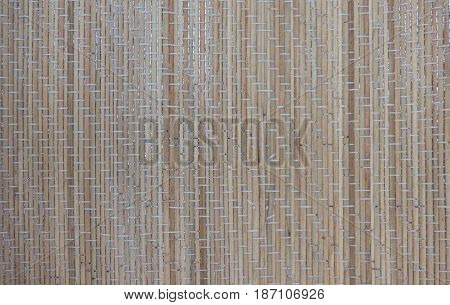 Light brown bamboo mat texture. Natural wood background. Wooden surface with vertical structure.
