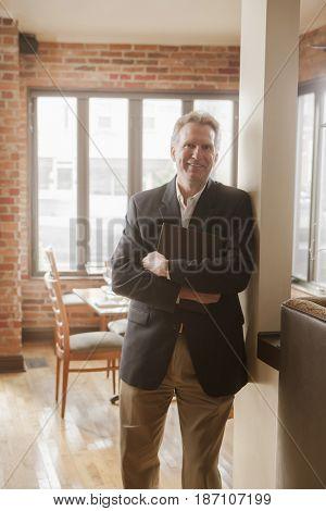 Caucasian owner standing in restaurant