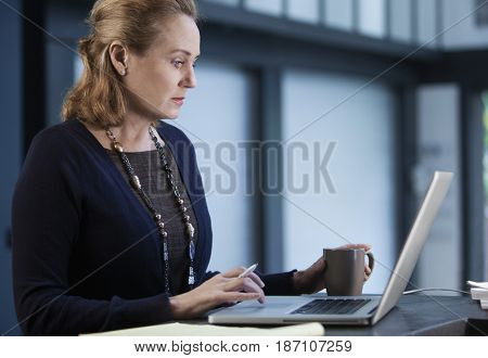 Caucasian businesswoman using laptop