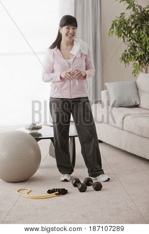 Asian woman relaxing after exercise
