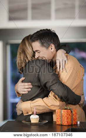Caucasian couple hugging