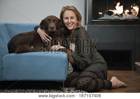 Caucasian woman hugging dog