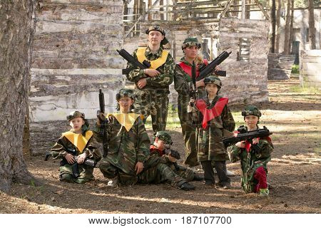 GOMEL BELARUS - May 15 2017: Children and adults play the collective game LASERTAG in the open air