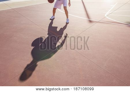 Caucasian man bouncing basketball