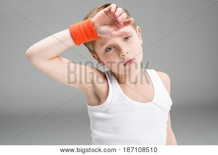 Tired Little Boy In Sportswear Looking At Camera Isolated On Grey, Children Sport Concept