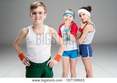 Cute Smiling Sporty Girls Looking At Happy Boy In Sportswear, Children Sport Concept