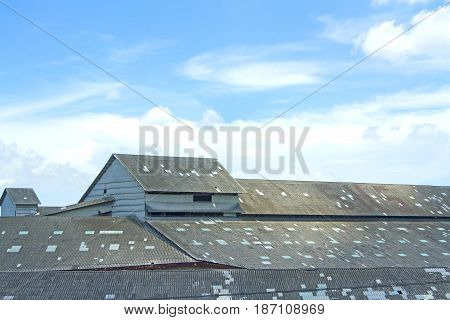 The roof of an old warehouse in the blue sky.