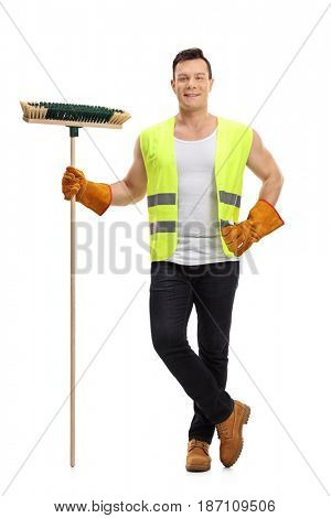 Full length portrait of a waste collector with a broom isolated on white background