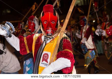 Quito, Ecuador - february 02, 2016: An unidentified people dressed up participating in the Diablada, popular town celebrations with people dressed as devils dancing in the streets.