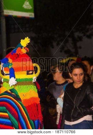Quito, Ecuador - february 02, 2016: An unidentified man dressed up participating in the Diablada, with a colorful mask in his head.