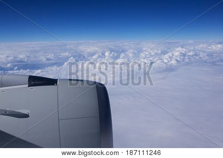 DUSSELDORF - 22nd JULY 2016: Singapore Airlines Airbus A350 clouds and blue sky through an aircraft window.