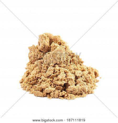 Pile of crushed and crumbled turkish halva confection, composition isolated over the white background