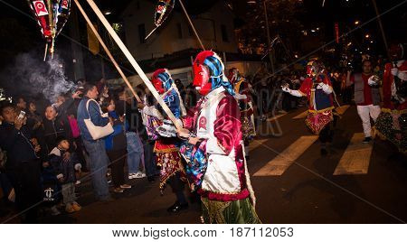 Quito, Ecuador - December 09, 2016: An unidentified people dressed up participating in the Diablada, walking through the streets.