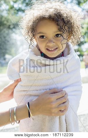 Mixed race girl wrapped in a towel