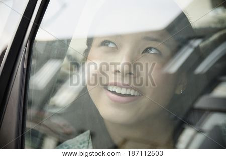 Asian woman riding in car
