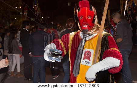 Quito, Ecuador - December 09, 2016: An unidentified people dressed up participating in the Diablada, popular town celebrations with people dressed as devil dancing in the streets.