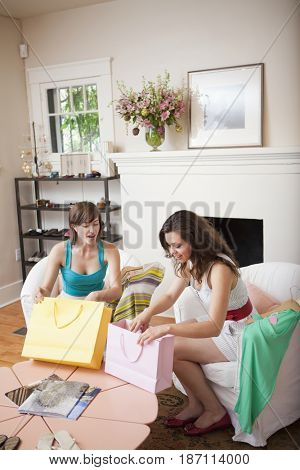 Hispanic woman looking into shopping bags
