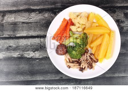 Fried Potato And Shimeji Mushroom With Mixed Vegetables.
