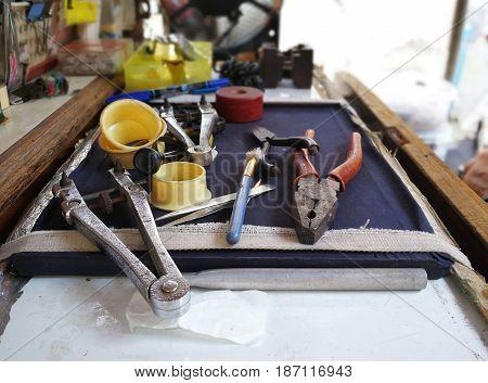 Watch repair craftsman repairing watch in Metal background