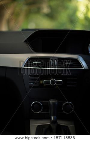 Close up dashboard and gearshift in car