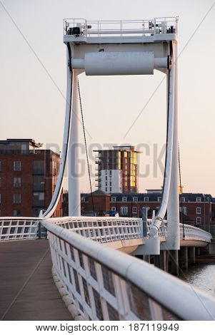 Gosport Hants UK - Dec 25 2014: Millennium Bridge on Forton Lake at high tide at sunset on 25 Dec in Gosport UK