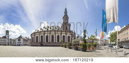 View To The Central Market Place With Trinity Church And Old Buildings In Worms, Germany