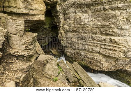 Dunnings Springs Cave - A spring flowing out of a cave.