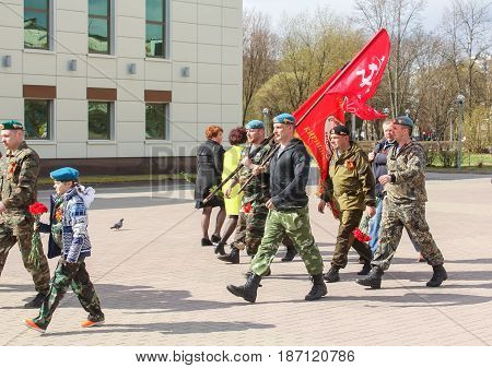 Kirishi, Russia - 9 May, Group of people with flags, 9 May, 2017. Preparation and conduct of the action Immortal regiment in small cities of Russia.