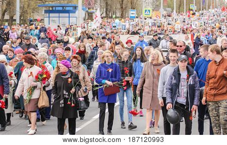 Kirishi, Russia - 9 May, A crowd of people on the stocks immortal regiment, 9 May, 2017. Preparation and conduct of the action Immortal regiment in small cities of Russia.