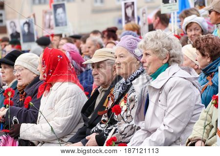 Kirishi, Russia - 9 May, Elderly people with flowers at a rally, 9 May, 2017. Holding a festive rally dedicated to the Victory Day.