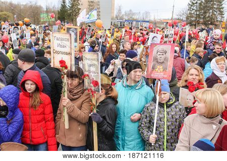 Kirishi, Russia - 9 May, People with portraits of those who died in the war, 9 May, 2017. Holding a festive rally dedicated to the Victory Day.