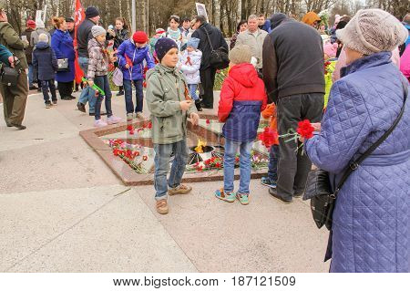 Kirishi, Russia - 9 May, Different people at the Eternal Flame, 9 May, 2017. Laying wreaths and flowers in memory of the fallen at the Eternal Flame.