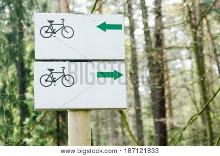 Signpost on the bicycle route in a forest