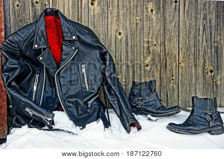 Black leather jacket and jacket near the wall