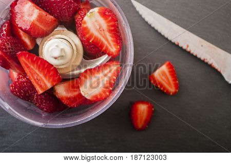strawberry cut ready to blend . Prep strawberry smoothies