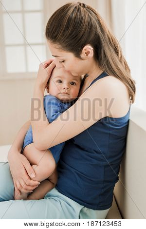 Portrait Of Beautiful Mother Hugging Her Son With Tenderness