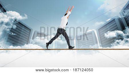 Digital composite of Digital composite image of businessman running on rope against servers