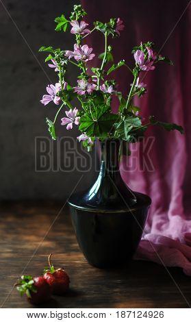 Vase with wildflowers. Wildflowers. Beautiful still life.
