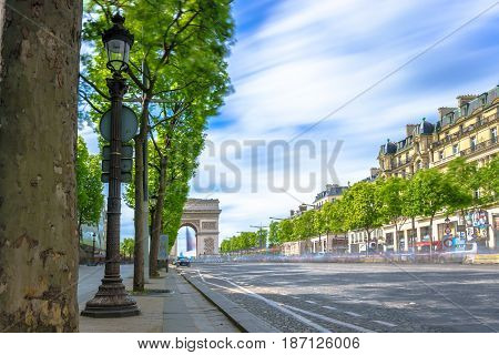 Paris France - May 1 2017: Long Exposure view of Champs-Élysées Avenue with cloudy sky background on May 1 2017 in Paris France.