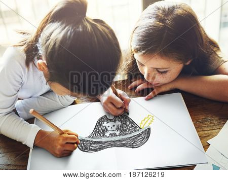 Child with a drawing of pirate hat