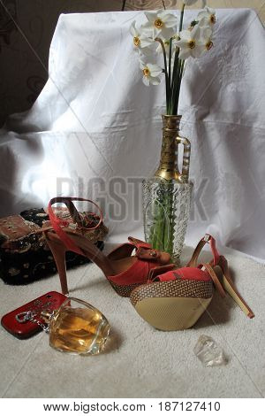 bouquet white aroma narcissus in vase, phone, shoes on heels, bottle of perfume spring time fall in love